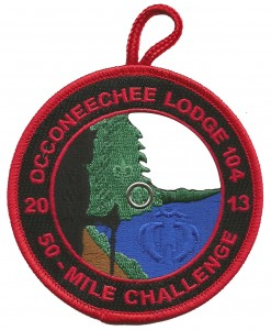 The red border eX2013-8 was the participant patch for those completing the 50 miles in 24 hours.